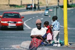 Mother and children by road in Johannesburg_jpg