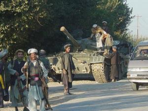 Afghan%20men,%20guns%20and%20tank_jpg
